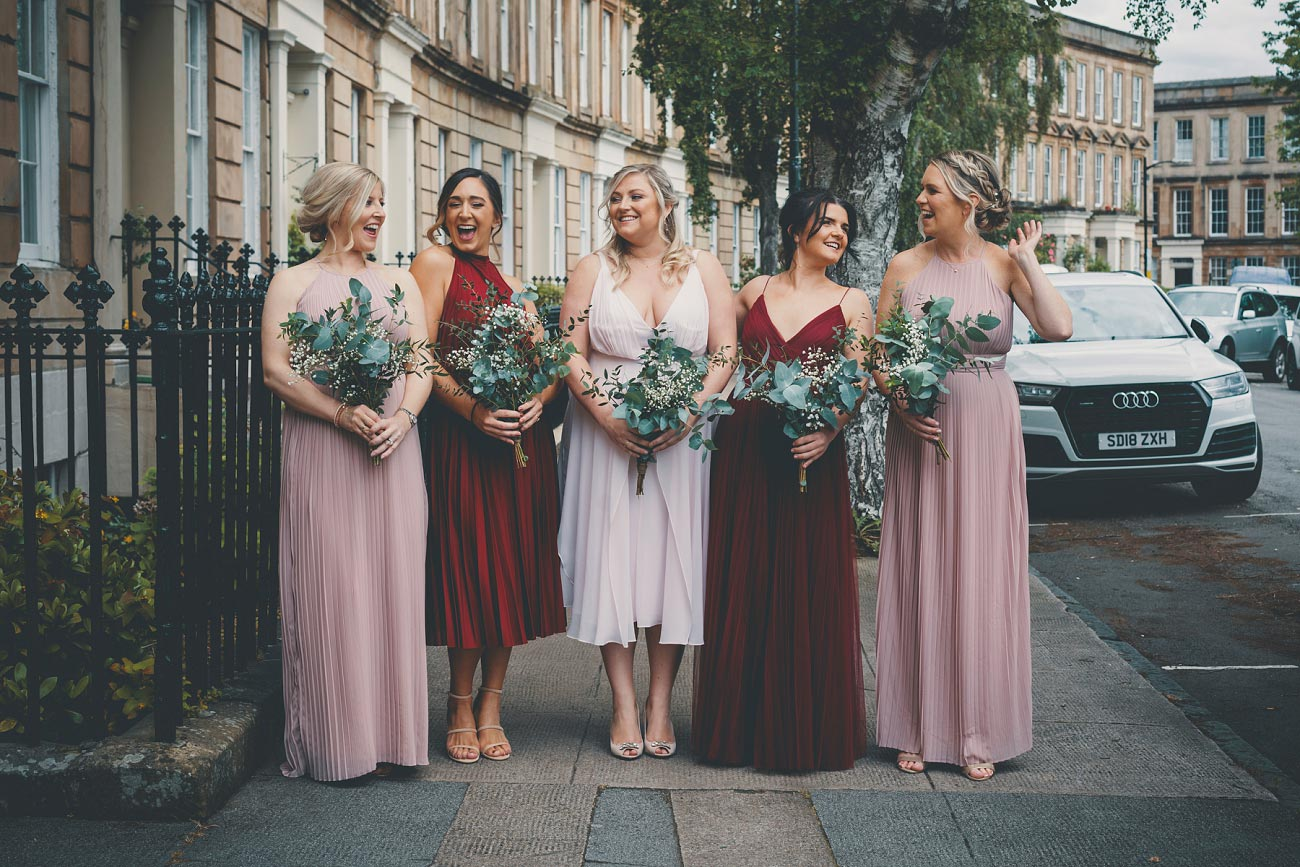bridesmaids in blush pink and red dresses